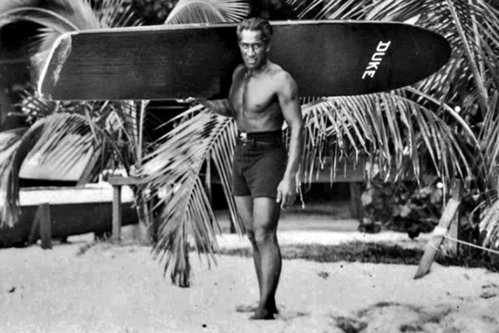 Duke Kahanamoku and His Surfboard